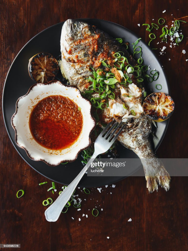 Barbecued whole snapper with sauce : Stock Photo