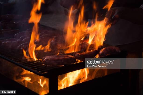 barbecuing chorizo sausages