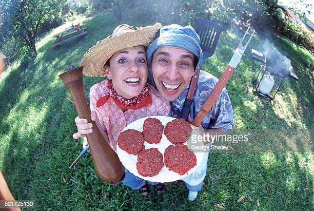 barbecuing couple - funny bbq stock pictures, royalty-free photos & images
