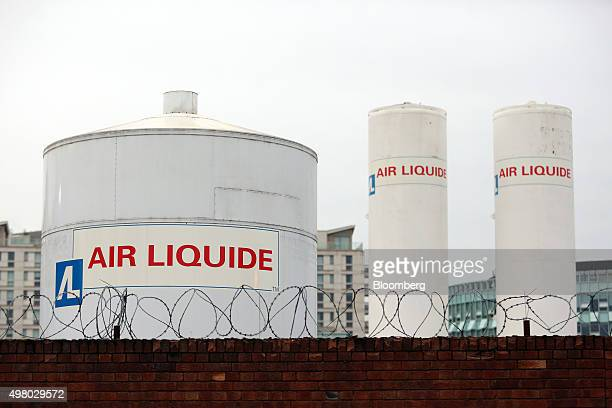 Barbed security wire sits on a wall near Air Liquide gas storage tanks at the Air Liquide SA distribution site in London UK on Friday Nov 20 2015 Air...