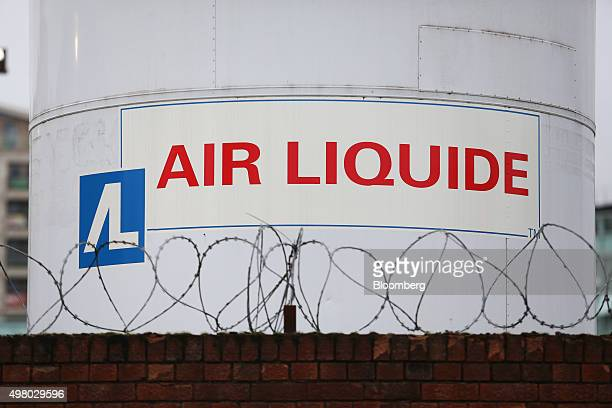 Barbed security wire sits on a wall near an Air Liquide gas storage tank at the Air Liquide SA distribution site in London UK on Friday Nov 20 2015...