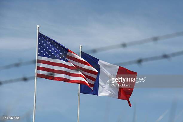 CONTENT] Barbed wire and American and French flags over Utah Beach Normandy