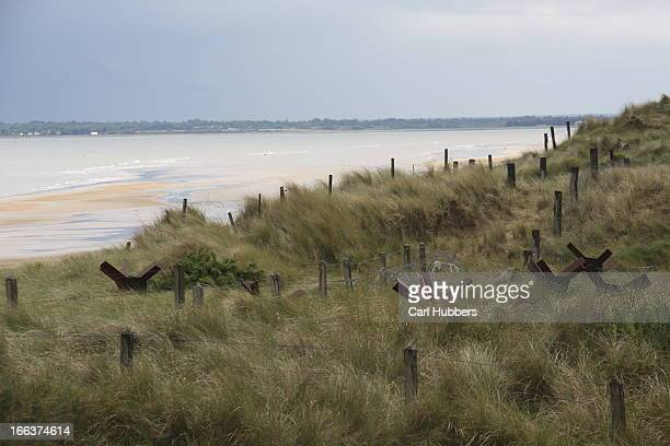 CONTENT] Barbed wire and anti tank defences Utah Beach Normandy France D Day 1945