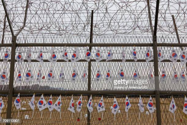 barbed wire border fence separates south from north korea - korean demilitarized zone stock pictures, royalty-free photos & images