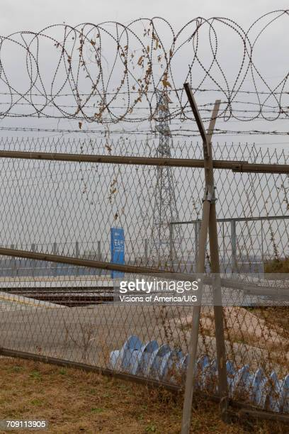 Barbed wire border fence separates South from North Korea