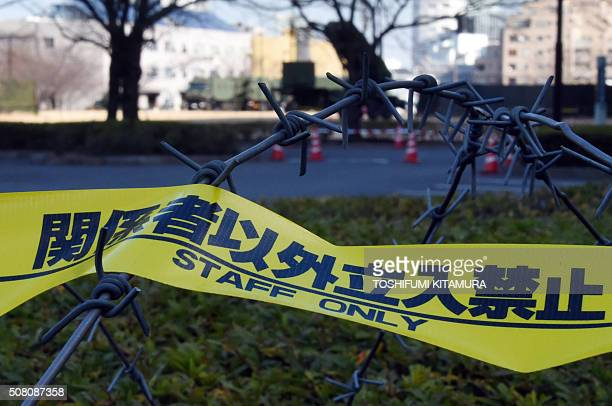Barbed wire cordoning off an area where a PAC3 missile launcher is deployed is seen on the grounds of the defence ministry in Tokyo on February 3...
