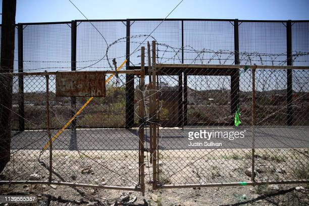 Barbed wire covers a fence in front of the fencing at the border of the United States and Mexico on March 31 2019 in El Paso Texas US President...