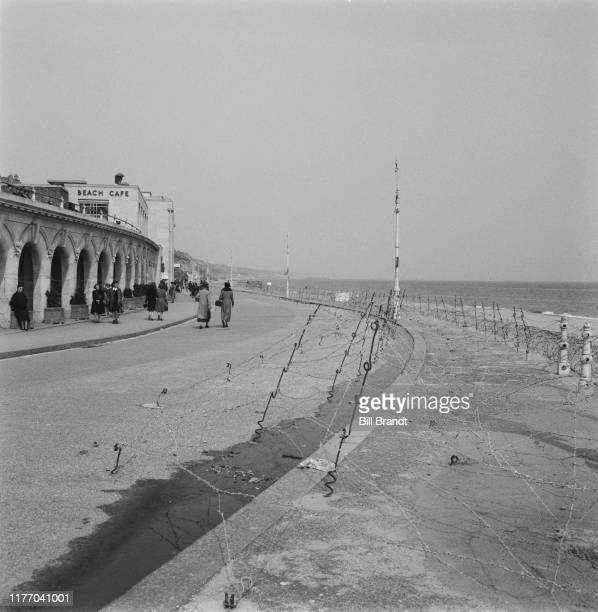 Barbed wire defences along the beachfront at Bournemouth Dorset June 1941 Original Publication Picture Post story 791 I Look At Bournemouth pub 21st...