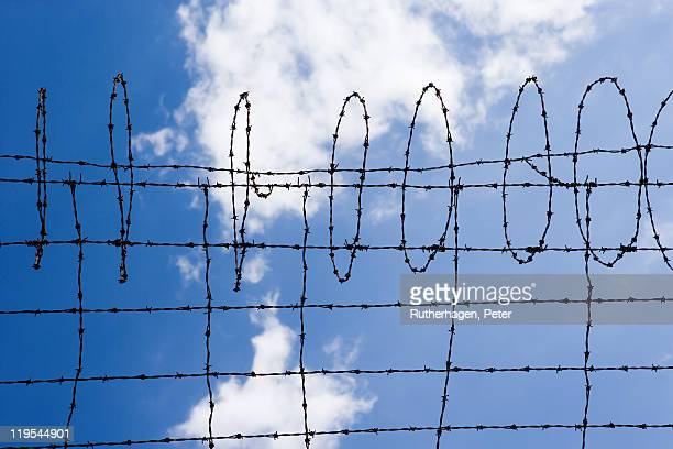 Barbed wire fence against sky