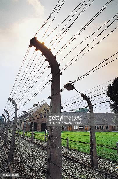 Barbed wire fence around Auschwitz concentration camp Poland