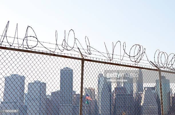 Barbed wire fence blocking the view of Manhattan