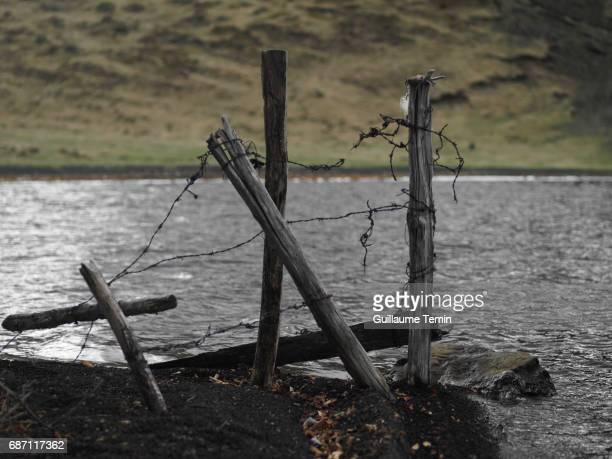Barbed wire fence destroyed