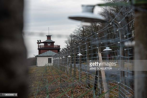 A barbed wire fence encloses the memorial site of the former Nazi concentration camp Buchenwald near Weimar eastern Germany on January 27 2020 A...