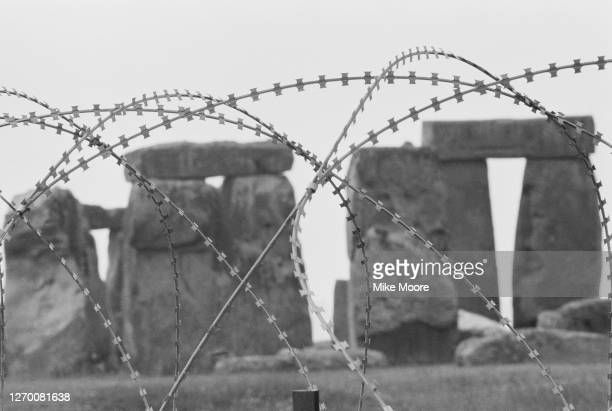 A barbed wire fence is erected around Stonehenge in Wiltshire UK to prevent damage to the site during the annal Free Festival 9th June 1985
