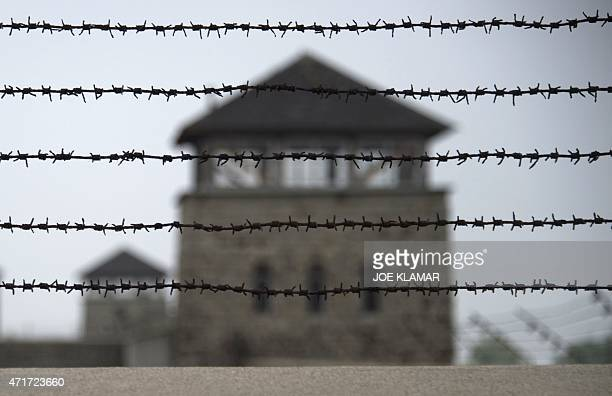 A barbed wire fence is pictured at the former Nazi concentration camp Mauthausen northern Austria on April 28 2015 AFP PHOTO / JOE KLAMAR