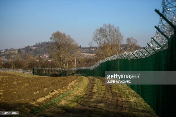 A barbed wire fence is set up along the SlovenianCroatian border in Rakovec in Slovenia on February 16 2017 Slovenia on January 26 2017 approved a...