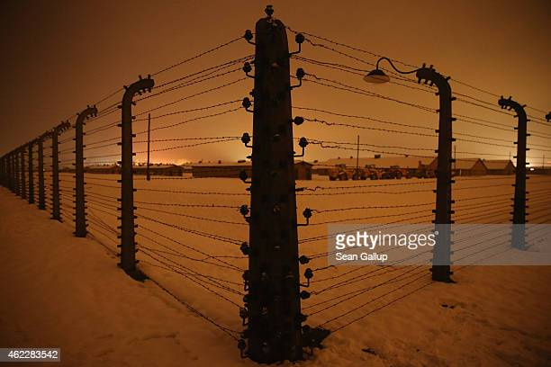 Barbed wire fence surrounds the former Auschwitz-Birkenau concentration camp on the night prior to commemoration events marking the 70th anniversary...