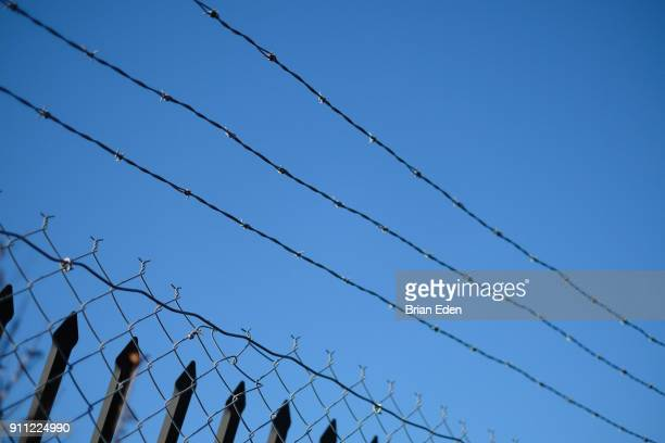 Barbed wire fence with a clear blue sky