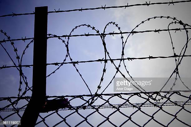 Barbed wire fence with heart shape
