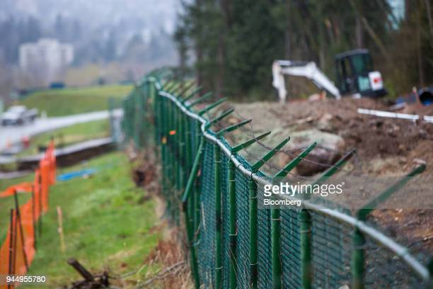 Barbed wire fencing stands at the Kinder Morgan Inc Trans Mountain pipeline expansion site in Burnaby British Columbia Canada on Wednesday April 11...