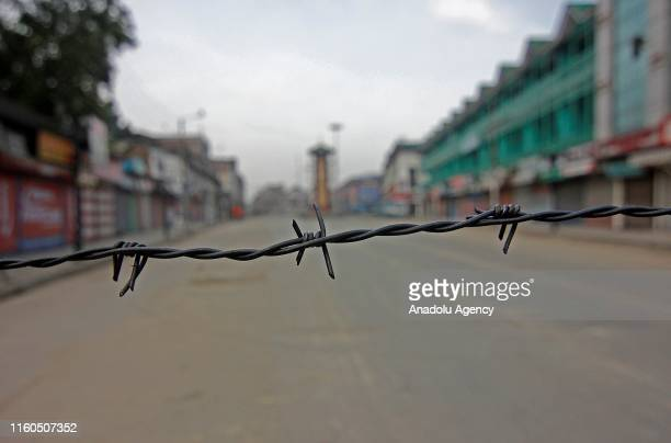 Barbed wire is used to block a road during a curfew in Srinagar Kashmir India on August 07 2019 The government has suspended internet and schools and...