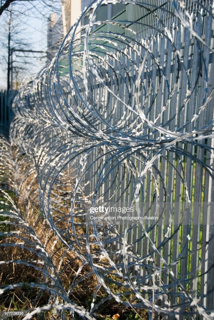Barbed wire security fence Pictures | Getty Images