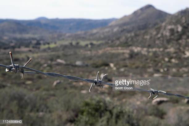 Barbed wire separates a portion of the USMexico border on January 24 2019 near Campo California The US government is currently partially shut down as...