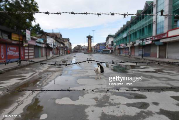 Barbed wire set up as barricading near Ghanta Ghar on August 19 2019 in Srinagar India Primary schools opened in Kashmir for the first time in a...