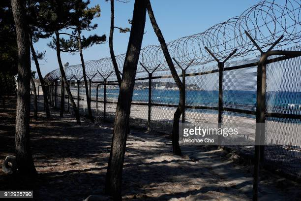 barbed wire stand along the beach in Gangneung Ganwon province in South Korea on February 1 2018 The North Korean athletes attending the PyeongChang...