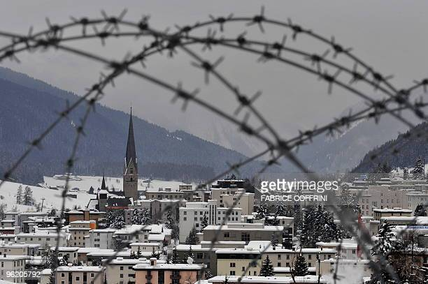 Barbed wires are seen backgounded by the ski resort of Davos on January 27 2009 near the Davos Congress Center on the eve of the opening of the World...