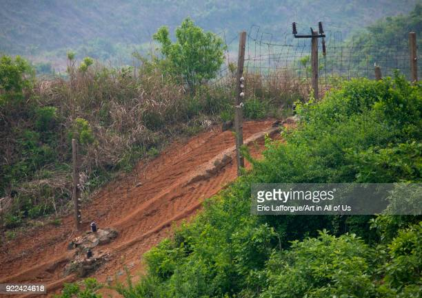 Barbed wires on the North Korean side in the Demilitarized Zone North Hwanghae Province Panmunjom North Korea on May 20 2009 in Panmunjom North Korea