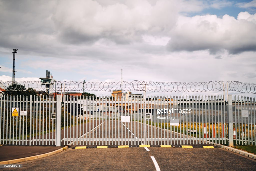 Barbed-wire lines a gate on the site of the former Swan Hunter shipyard in Wallsend, U.K., on Thursday, Sept. 6, 2018. The northeast of England illustrates the precarious position facing many parts of the U.K. just six months before the country is due to leave the EU. Photographer: Matthew Lloyd/Bloomberg via Getty Images