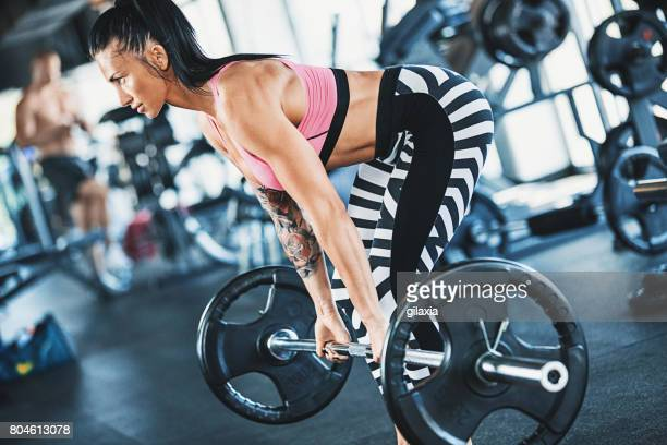 Barbell dead lift exercise.