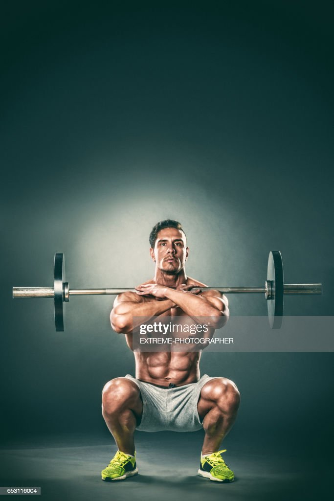 Barbell front squats lower position : Stock Photo
