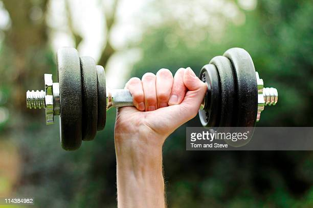Barbell lifting in park