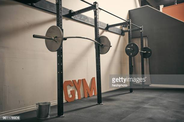 barbells in gym - heshphoto stock pictures, royalty-free photos & images