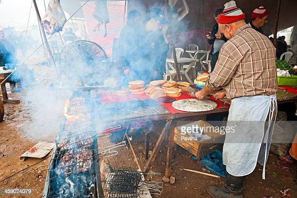 barbeque at food market in azrou morocco africa - pavliha stock photos and pictures