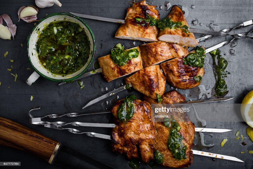 Barbequed chicken breast skewers with chimichurri sauce : Stock Photo