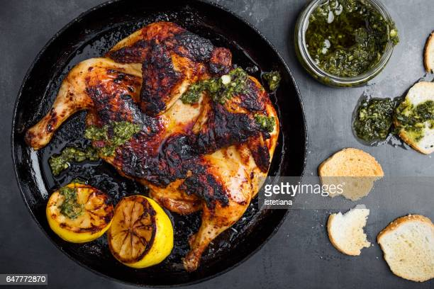 barbequed chicken with chimichurri sauce - barbeque sauce fotografías e imágenes de stock