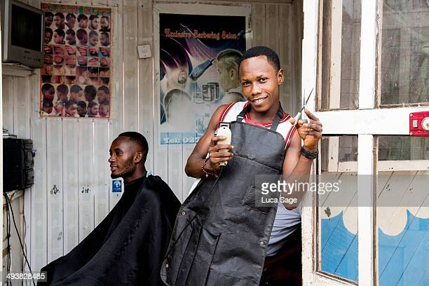 Barber at work in West Africa