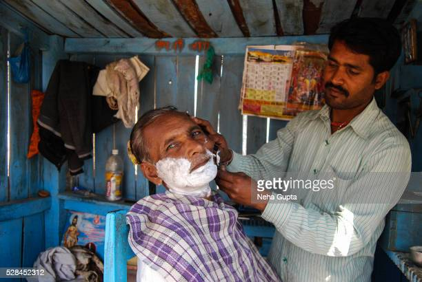 a barber at work - neha gupta stock pictures, royalty-free photos & images