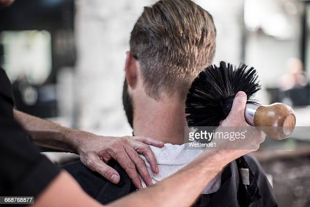 Barber brushing of customer