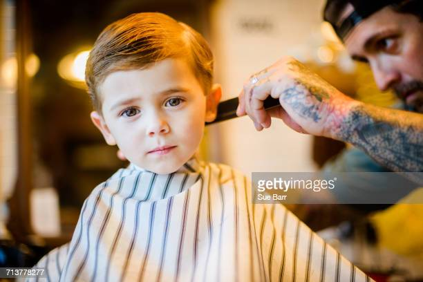 barber combing boys hair - 髪の分け目 ストックフォトと画像