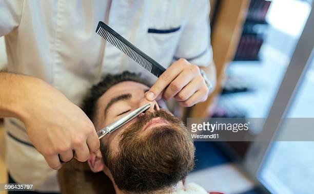 barber cutting beard of a customer - 鼻 ストックフォトと画像