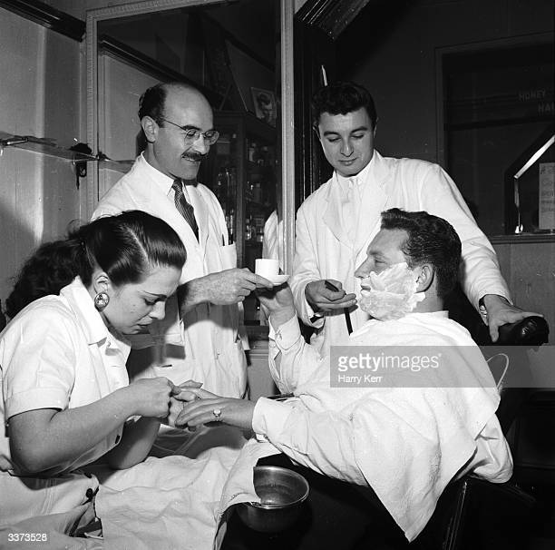 Barber David Crook offers a customer a cup of coffee while he has a shave and manicure Mr Crook is locked in a trade battle with Claude Barnett a...