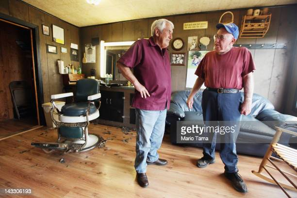 Barber Gary Mays chats with retired butcher Jesse Johnson in Mays' barber shop in Owsley County on April 20 2012 in Booneville Kentucky Daniel Boone...