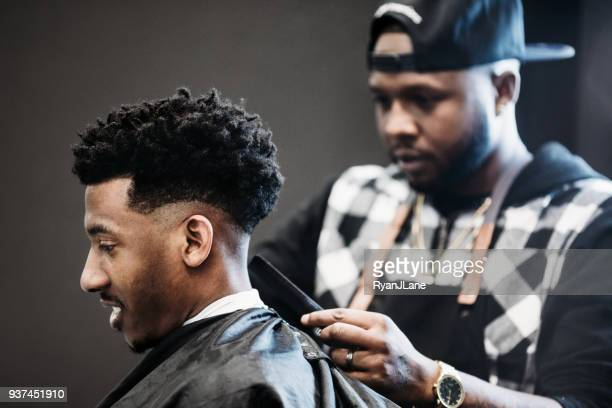 Barber Giving A Haircut in His Shop