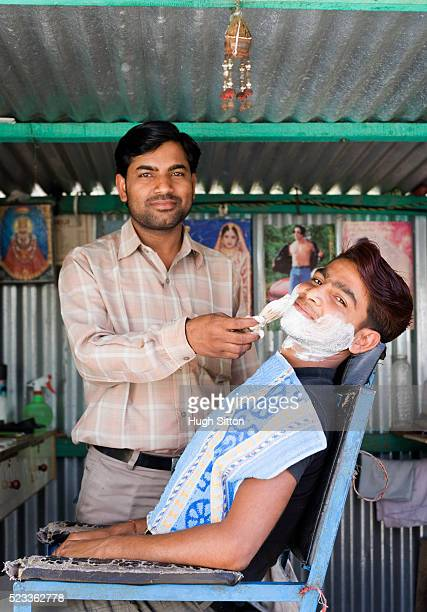 barber giving customer a shave - hugh sitton stock pictures, royalty-free photos & images