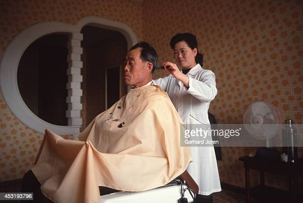 A barber inside the 45 story Koryo Hotel in Pyongyang Only the left tower was in use when I was there in 1989 and again in 1994 The walls to some of...