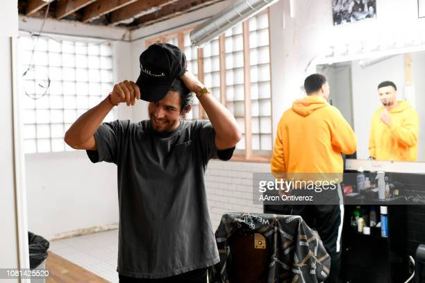Barber Josue 'Sway' Navarro adjusts his cap after working on Denver Nuggets guard Jamal Murray at Bellwether Barbershop on Wednesday January 9 2019...